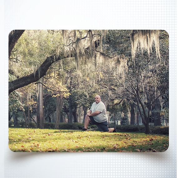 SJC Man Kneeling Under Tree
